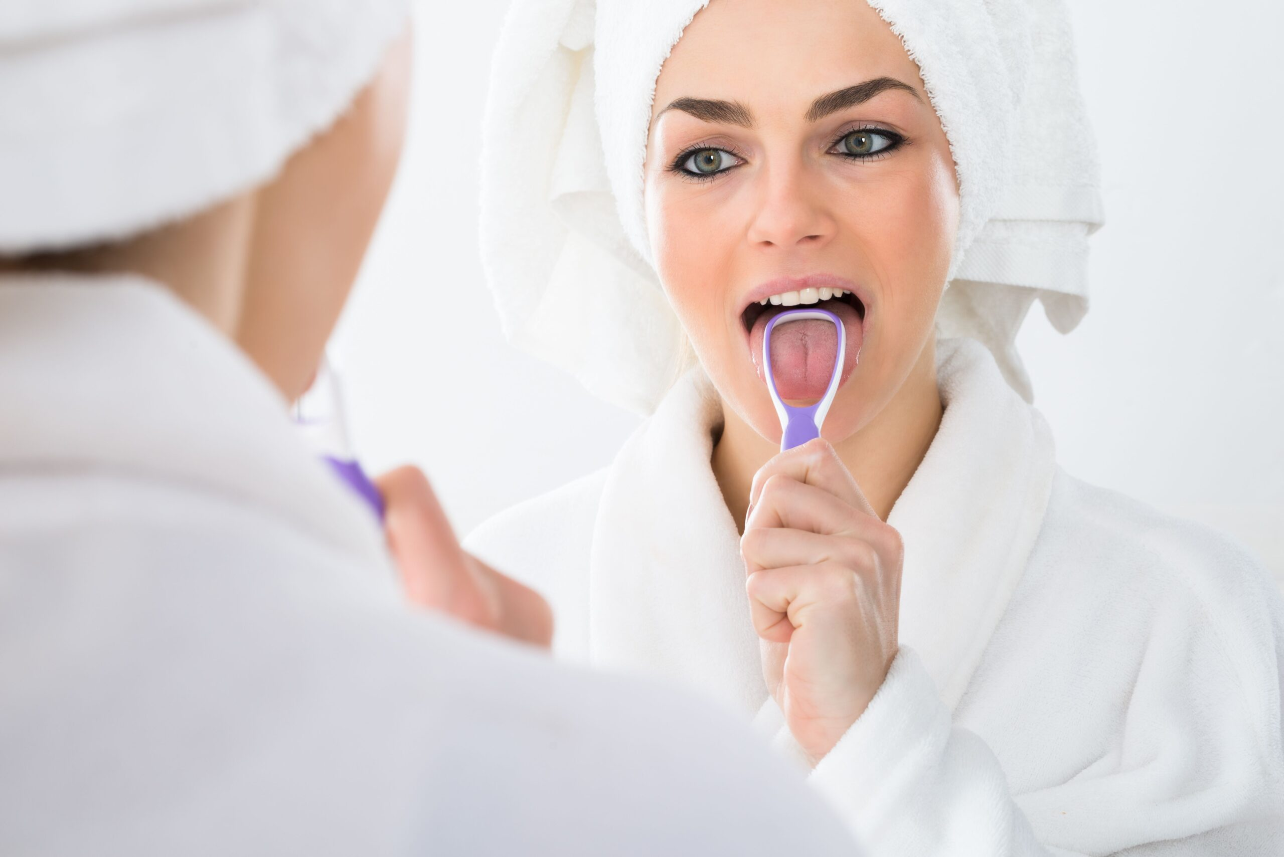 Dentist LeMars | Should I Be Using a Tongue Scraper?
